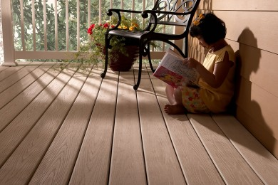 Girl is sitting on VEKAdeck decking solution