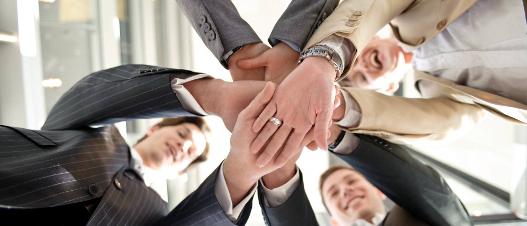 Colleagues buildig circle with hands
