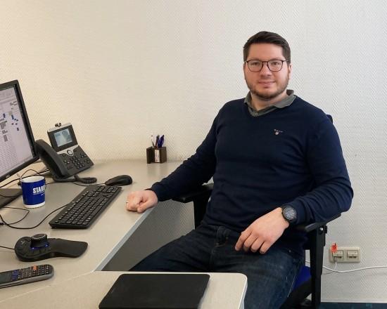 Schmelzer at his desk